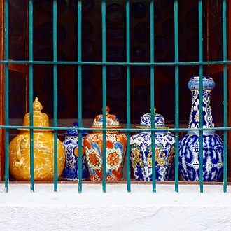"Talavera pottery - Jars in the window of workshop ""Taller Armando""."