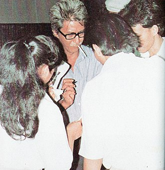 Teguh Karya - Karya signing an autograph at the 1982 Indonesian Film Festival.