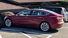 Tesla Model 3 parked, rear driver side.jpg