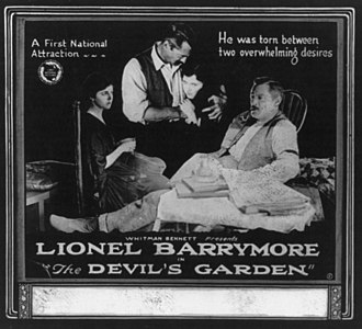 Lionel Barrymore - Lionel and first wife Doris (in rocking chair) in 1920 silent film The Devil's Garden.