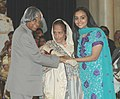 The President, Dr. A.P.J. Abdul Kalam presenting the Padma Bhushan Award – 2006 to a well known Hindi Writer Dr.(Smt.) Dineshnandini Dalmia, in New Delhi on March 20, 2006.jpg