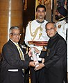 The President, Shri Pranab Mukherjee presenting the Padma Bhushan Award to Prof. Jyeshtharaj Bhalchandra Joshi, at a Civil Investiture Ceremony, at Rashtrapati Bhavan, in New Delhi on March 31, 2014.jpg