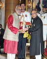 The President, Shri Pranab Mukherjee presenting the Padma Shri Award to Prof. Ashok Gulati, at a Civil Investiture Ceremony, at Rashtrapati Bhavan, in New Delhi on March 30, 2015.jpg
