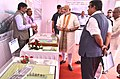 The Prime Minister, Shri Narendra Modi being briefed about the Projects under Namami Gange & National Highway projects, in Mokama, Bihar.jpg