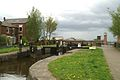 The eighth lock, with the A577 crossing Rose Bridge behind - geograph.org.uk - 143351.jpg