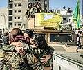 Three YPJ soldiers hugging.jpg