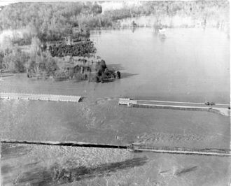 U.S. Route 45 - Failure of the Mississippi Highway 25 N/U.S. Route 45 S bridge over the Tombigbee River relief (Big Nichols Creek)/Tennessee–Tombigbee Waterway in Aberdeen, Mississippi,  during the March 1955 floods.
