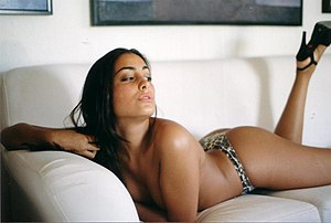 Topless woman on sofa.jpg