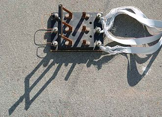Switch - Triple-pole single-throw (TPST or 3PST) knife switch used to short the windings of a 3‑phase wind turbine for braking purposes. Here the switch is shown in the open position.