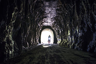 Elroy-Sparta State Trail - A bicyclist enters one of the tunnels.