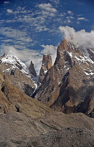 Cliff - The Trango Towers in Pakistan. Their vertical faces are the world's tallest cliffs. Trango Tower center; Trango Monk center left; Trango II far left; Great Trango right.