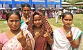 Tribal female voters showing their indelible ink after casting their votes, at a polling booth, during the 2nd phase of Assam Assembly Election, at Pamoi village, in Kamrup district on April 11, 2016.jpg