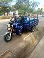 Tricycle carrying charcoal stove in Arua District.jpg