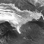 Tuxedni Glacier, terminus of valley glacier, and trimline along mountain sides, August 25, 1964 (GLACIERS 6919).jpg