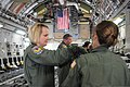 U.S. Air Force 1st Lt. Bonnie Kembal, left, a flight nurse with the 139th Aeromedical Evacuation Squadron, New York Air National Guard, secures a patient litter to a rack in the cargo bay of a C-17 Globemaster 130601-Z-GJ424-023.jpg
