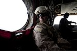 U.S. Marine Corps Col. James Donnellan, foreground, an operations officer with Regional Command (Southwest), looks out the window of a British Army CH-47 Chinook helicopter while departing Main Operating Base 130729-M-RF397-097.jpg