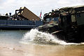 U.S. Marines from Combat Logistics Battalion 8, Transportation Support Company, work together with Navy personnel from Beach Master Unit 2 off-loading ISO containers off a Landing Craft Utility during 120615-M-KS710-159.jpg
