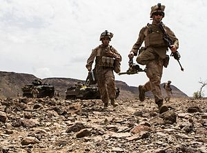 26th Marine Expeditionary Unit - U.S. Marines of Company K, Battalion Landing Team 3/2, 26th Marine Expeditionary Unit (MEU), sprint to the gun line with their 60mm mortars during their sustainment training in the U.S. 6th Fleet area of responsibility, 7 August 2013.