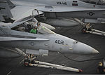U.S. Marines work on an F-A-18C Hornet aircraft assigned to Marine Fighter Attack Squadron (VMFA) 323 on the flight deck of the aircraft carrier USS Nimitz (CVN 68) June 15, 2013, in the Gulf of Oman 130615-N-KE148-082.jpg