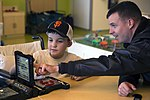 U.S. Navy Capt. plays the board game Battleship with a patient at Children's Hospital. (30116294906).jpg