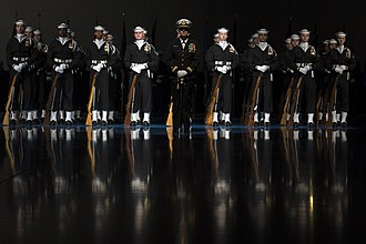 Navy Ceremonial Duty Ribbon - U.S. Navy Ceremonial Guard from the Naval District Washington, D.C. stand in formation for the Armed Forces Full Honor Farewell Review Ceremony in honor of the Secretary of Defense at Joint Base Myer-Henderson Hall in January 2017.