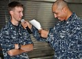 U.S. Navy Fire Controlman 2nd Class Paul Wright spells a word correctly to win a spelling bee on amphibious transport dock ship USS Denver (LPD 9) while in the East China Sea Oct. 9, 2011 111009-N-PV215-070.jpg