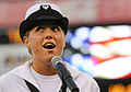 U.S. Navy Musician 3rd Class Sarah Janiak, a member of the U.S. Fleet Forces Band, sings the national anthem while participating in the Norfolk Tides annual Navy Day celebration at Harbor Park in Norfolk, Va 090821-N-DU164-054.jpg