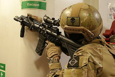 A Brazilian soldier moves down an escape corridor UNITAS LX (48707178867).jpg