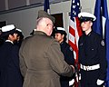 US Navy 030204-N-7217H-003 Lt. Col. Roland Eisel, U.S. Marine Corp (Ret), Navy Junior Reserve Officer's Training Corps (NJROTC) Area 13 Manager, inspects the uniforms of Sasebo's NJROTC color guard cadets.jpg