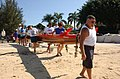 US Navy 030601-N-0106C-003 Members of the Honolulu Pearl Canoe Club (HPCC) take their koa wood canoe, locally known as a Honaunau, into the waters of Keehi Lagoon in preparation for competition against other canoe teams.jpg