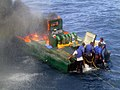 US Navy 040202-N-0000X-001 The crew aboard the 50 ft boat set their boat on fire to destroy contraband.jpg
