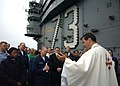 US Navy 040411-N-1045B-072 Navy Chaplain Lt. Joe Coffey, of Philadelphia, Pa., delivers the Catholic Easter communion service on the flight deck aboard USS George Washington (CVN 73).jpg