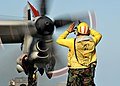 US Navy 040419-N-7408M-001 Aviation Boatswain's Mate 1st Class Caron L Curry, of Memphis, Tenn., directs an E-2C Hawkeye.jpg