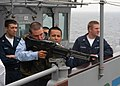 US Navy 040420-N-6433N-097 Crewmembers assigned to USS George Washington (CVN 73) visit the guided missile cruiser USS Vella Gulf (CG 72) to fire an M-60 rifle.jpg