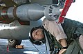 US Navy 040428-N-1045B-035 Lt. Javier Lee from Virginia Beach, Va., checks a Laser-Guided Bomb on an F-14B Tomcat.jpg