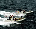 US Navy 040716-N-8704K-001 USS John F Kennedy (CV 67) and the USS Vicksburg (CG 69) crew members take part in a small boat attack drill in the Arabian Gulf.jpg