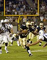 US Navy 040904-N-9693M-006 U.S. Naval Academy Midshipman 1st Class Aaron Polanco runs for a touchdown.jpg