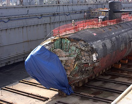 USS San Francisco in dry dock in Guam in January 2005, following its collision with an uncharted seamount. The damage was extensive and the submarine was just barely salvaged. US Navy 050127-N-4658L-030 The Los Angeles-class fast-attack submarine USS San Francisco (SSN 711) in dry dock to assess damage sustained after running aground approximately 350 miles south of Guam Jan. 8, 2005.jpg