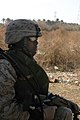 US Navy 050226-M-8205V-001 U.S. Navy Hospital Corpsman 3rd Class Derek Collins, assigned to 1st Squad, 3rd Platoon, I Company, 3rd Battalion, 5th Marine Regiment, 1st Marine Division, provides security while on patrol outside t.jpg