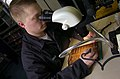 US Navy 050305-N-1485H-059 Aviation Electronics Technician 2nd Class Robert Craig of Union City, Tenn., repairs a micro-miniature circuit card in the Avionics Workcenter at the Aircraft Intermediate Maintenance Department (AIMD.jpg