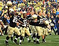 US Navy 051008-N-9693M-022 Members of the U.S. Naval Academy football team run across the field toward the home team stands in celebration of their victory over Air Force 27-24 at Navy-Marine Corps stadium.jpg