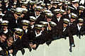 US Navy 051203-N-0295M-007 Midshipmen watch as the Army's West Pont Cadets march off the field during opening ceremonies for the 106th playing of the Army vs. Navy Football game.jpg