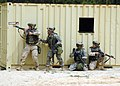 US Navy 060323-N-0057D-238 Naval Reservists and Active Duty personnel work together testing their urban warfare capabilities.jpg