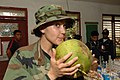 US Navy 060529-N-6501M-024 Maj. Mary Ann Garbowski of the Defense Logistics Agency (DLA), takes a moment to enjoy the juice from a coconut.jpg