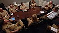 US Navy 060626-N-3659B-001 Commander, Navy Recruiting Command Rear Adm. Jeffrey L. Fowler briefs on the recruiting mission to Master Chief Petty Officer of the Navy (MCPON) Terry Scott and Perspective Master Chief Petty Officer.jpg