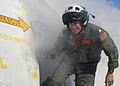 US Navy 070329-N-5060B-052 Lt. Cmdr. Charles Dittbinner II escapes the smoky fuselage of a P-3C Orion, assigned to Patrol Squadron (VP) 16, while conducting emergency landing and egress training.jpg
