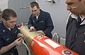 US Navy 070412-N-9851B-001 Torpedoman's Mate 3rd Class Brian Reed checks the dye pack of a MK-46 exercise torpedo before a torpedo launch exercise as Torpedoman's Mate Seaman Russell Spoon and Chief Sonar Technician Ray Reyes o.jpg
