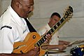 US Navy 070524-N-2908O-003 Musician First Class Andre Avelino, lead guitarist and band leader for Navy Band Mid-South's Jazz Combo Group plays a guitar with three other Navy musicians in the Arkansas State Capitol Buildin.jpg
