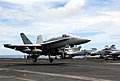 US Navy 070807-N-9760Z-002 An F-A-18C Hornet, assigned to the Sunliner's of Strike Fighter Squadron (VFA) 81, lands on the flight deck of the nuclear-powered aircraft carrier USS Nimitz (CVN 68).jpg