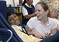 US Navy 071016-N-6524M-002 Hospital Corpsman 2nd Class Rita Rombaoa participates in a community relations project at the Dubai Center for Special Needs.jpg
